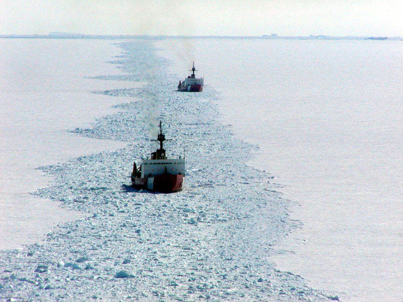 The heavy ice breakers Polar Star and Polar Sea create an access channel for supply ships in McMurdo Sound, during the 2002 Deep Freeze Mission. The Polar Sea is now in caretaker status and could be decommissioned. The Polar Star has undergone a thee-year $90 million overhaul. Courtesy U.S Coast Guard.