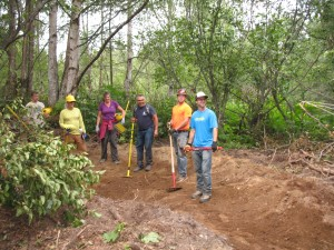 Volunteers from the Singletrack Advocates shaping a turn on the new trails at Kincaid Park.