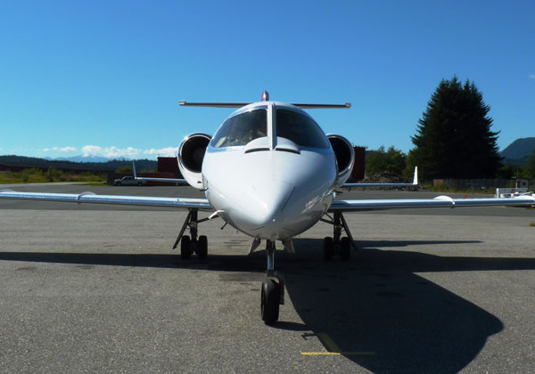 An Airlift Northwest Lear Jet waits for a medevac call at Juneau's airport. Airlift continues offering medevac insurance, but Apollo Medi Trans lost its state license to renew or issue policies in February. EdSchoenfeld/CoastAlaska photo.