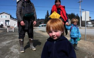 Two-year-old Lituya smiles for the camera outside the KBBI studios in Homer (Aaron Selbig photo)