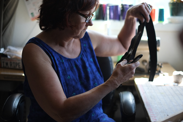 Kodiak Coat Company owner Bridget Milligan in her workshop in downtown Juneau . Photo by Annie Bartholomew/KTOO