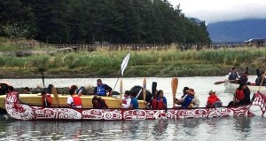 One of the Gathering Strength Canoe Journey vessels floats next to an accompanying boat along the way. Photo courtesy Diane Raymond Stewart of Kingcolith, B.C.