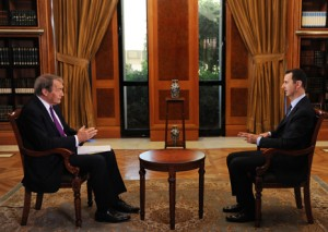Charlie Rose and Bashar al-Assad (Photo credit: CBS News)