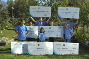 Honorees pose with their awesome jumbo checks.