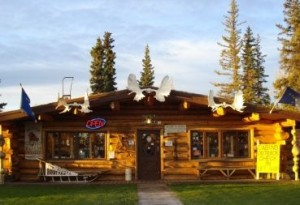 The Burnt Paw & Cabins Outback, located next door to Tok's Westmark Hotel, is a popular attraction for the tourists riding on the Holland America buses traveling to and from Dawson City, Yukon Territory. Photo by Nancy Arpino.