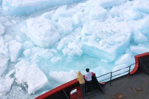 Scientists watch from the deck of the U.S. Coast Guard Cutter Healy as it cuts through multiyear sea ice in the Arctic Ocean on July 6, 2011. —Credit: NASA/Kathryn Hansen