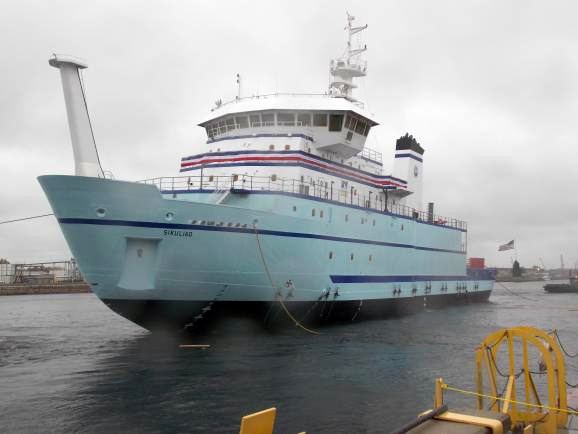 Sikuliaq floats in the Menominee River just after launch. Photo by Dan Bross, KUAC - Fairbanks.