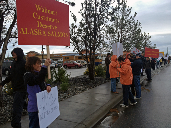 Protesters gather outside the South Anchorage Walmart, demanding the store carry Alaska salmon. Photo by Daysha Eaton, KSKA - Anchorage.
