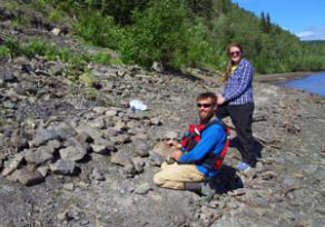 The crew found dozens of dinosaur tracks along one Yukon River beach. Pat Druckenmiller and Katherine Anderson assess some of the tracks. Photo by Kevin May.