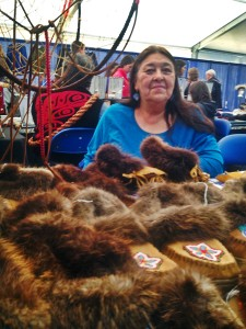 1.Donna Pulliam of Chugiak sells handmade, beaded slippers and other work at the AFN convention. Photo by Emily Schwing, KUAC - Fairbanks.