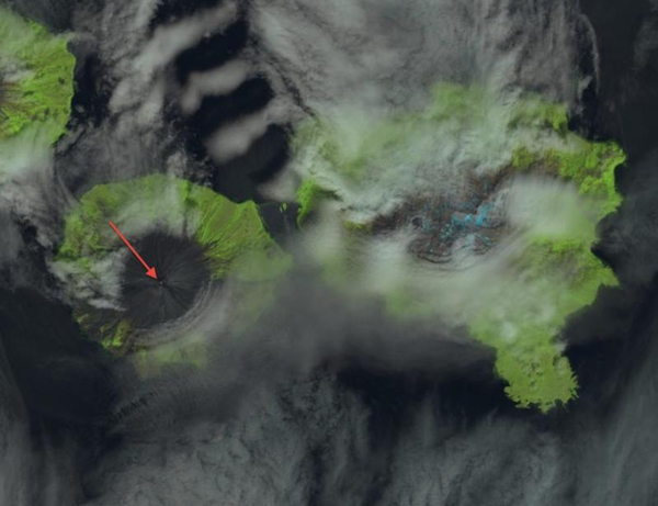 False-color composite image of Cleveland volcano collected by Landsat-8 on July 26, 2013. This image is a composite of the short-wave infrared data (to show thermal emissions) and high temperatures in the summit crater as shown as a small red region (indicated by the arrow). These hot temperatures are likely due to the extrusion of a small lava dome.Credit Dave Schneider