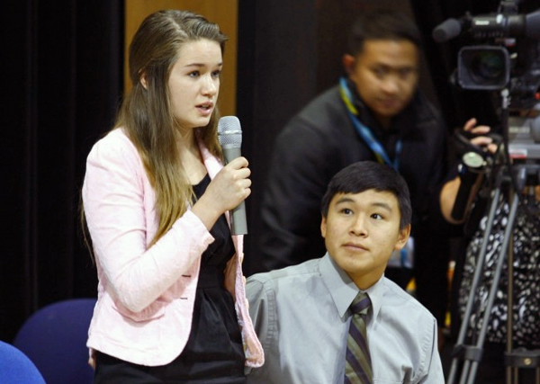 Katherine Dolma answers a question following a Supreme Court LIVE hearing at Barrow High School. Dolma and Nelson Kanuk, seated, are two of the six young plaintiffs in the case. Photo by Jeff Seifert, KBRW - Barrow.