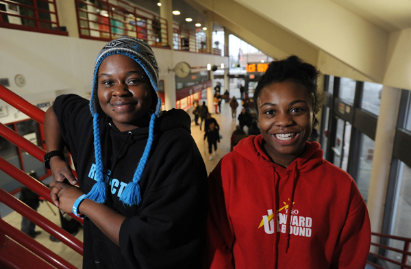 Judy Ayers, 19, left, and Calesia Monroe, 16, are outreach workers at Alaska Youth Advocates on the second floor of the Downtown Transit Center where they work with homeless teenagers. Photo by Bill Roth, Anchorage Daily News.