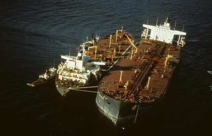 Exxon Valdez tanker aground. Off-loading of remaining oil in progress. Photo courtesy of the Exxon Valdez Oil Spill Trustee Council.