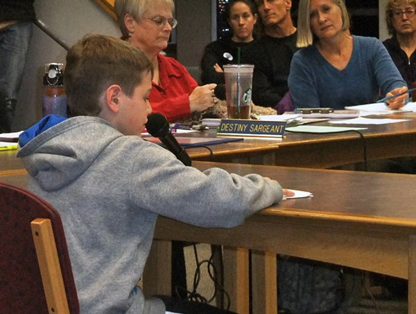 DZMS student Connor Norman presented the board with a petition to reconsider the board's policy banning sports travel for middle schools. Photo from KTOO - Juneau.