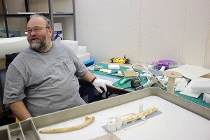 Museum professional Jon Loring takes a break from creating custom storage mounts for ivory pipes. Photo by Lisa Phu, KTOO - Juneau.