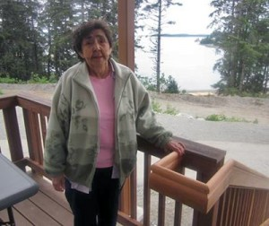 Elder Marge Adams stands on the porch at the new Yakutat Senior Center. Photo courtesy Tlingit and Haida Regional Housing Authority.
