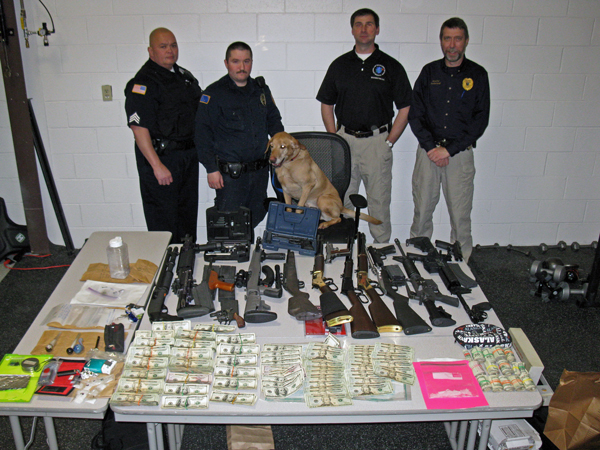 Police seized drugs, firearms, and cash as evidence. Photo courtesy of UDPS.