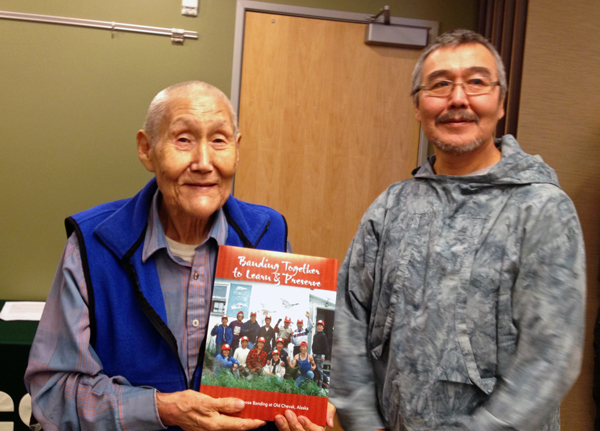 Chevak elder Leo Moses (left) stands with traditional council chief James Ayuluk (right). Photo by Lori Townsend, APRN - Anchorage.