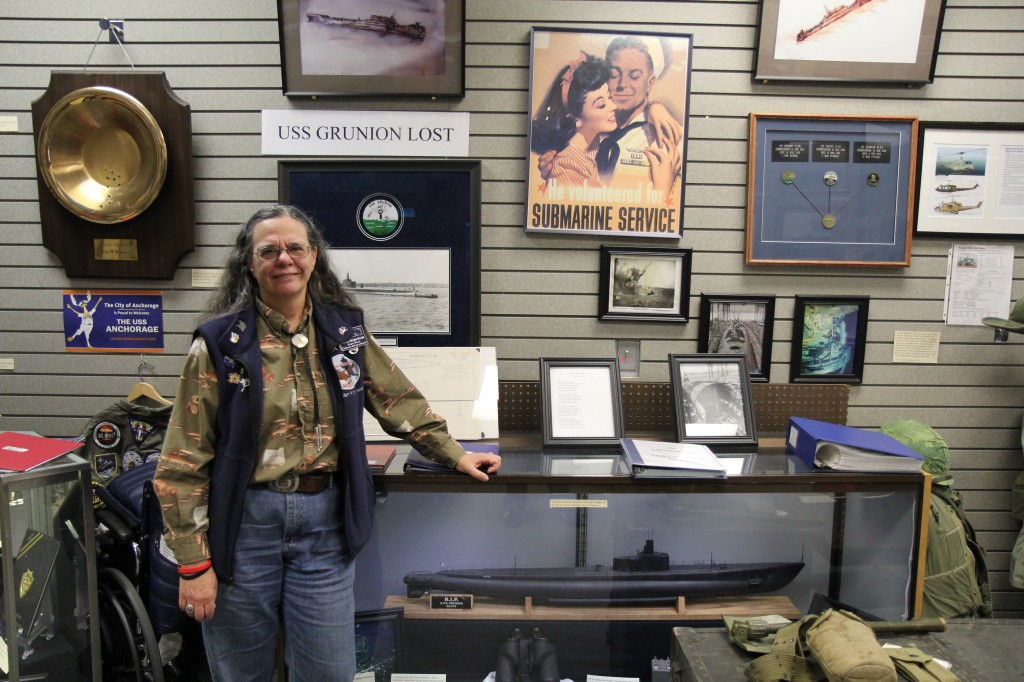Col. Suellyn Novak poses with a model USS Grunion, a submarine lost in WWII.