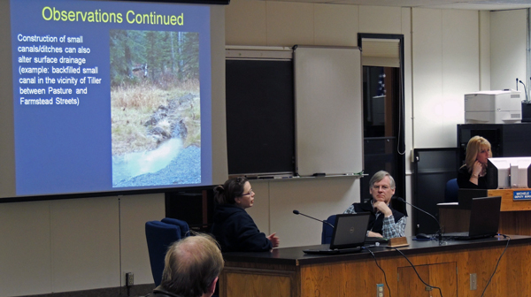 Melissa Hill (left) of the Department of Natural Resources and David Shady of the Department of Environmental Conservation present their research to the Borough Assembly Tuesday night. Photo by Shaylon Cochran, KDLL - Kenai.