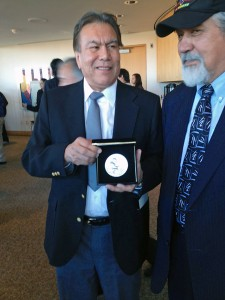 "Robert ""Jeff"" David Jr., left, holds the silver medal awarded to his dad, who the family just learned was a code talker. David, of Haines, traveled to Washington, DC with former legislator Bill Thomas. Photo by Liz Ruskin, APRN - Washington DC."