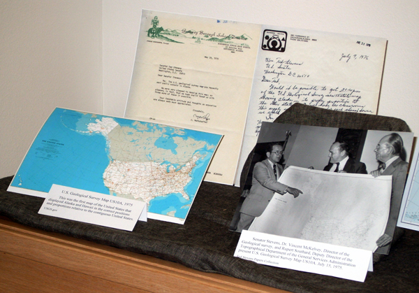 The Ted Stevens Papers Project's new mapping exhibit includes a small-scale version of The Stevens Map, left, and a photo of Stevens showing off the full-scale version of the map after it was published in 1975. Photo by Tim Ellis, KUAC - Fairbanks.