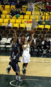 UAA's Alli Madison goes in for a layup against Georgetown in the Great Alaska Shootout championship. Photo by Josh Edge, APRN - Anchorage.