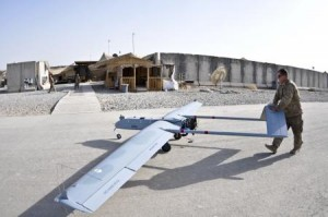 U.S. Army Spc. Joseph Anderson, with Headquarters and Headquarters Troop, Combined Task Force Dragoon, pushes an RQ7B Shadow Technical Unmanned Aircraft System to a mechanical station for post-flight checks at Forward Operating Base Pasab, in Kandahar Province, Afghanistan, Sept. 12, 2013. The aircraft was used for aerial reconnaissance and mission communications. (U.S. Army Photo by Spc. Joshua Edwards/Released)