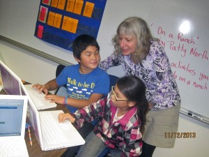 Alaska's Teacher of the Year 2014 Denise Lisac with DES fourth graders Morgan Allen and Laci Andrew.Photo by Shannon Clouse.