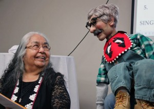 "Native elder Florence Sheakley shares a warm smile with Charlie. About ventriloquism, she says, ""It was awesome to see that Tlingits can do this."" Photo by Lisa Phu, KTOO - Juneau."