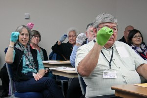 Session participants, including ANB Grand President Bill Martin and poet and translator Richard Dauenhauer, all practiced ventriloquism with sock puppets.  Photo by Lisa Phu, KTOO - Juneau.