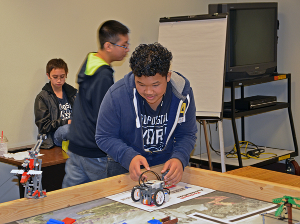 Johnny Khongsuk sets up the Unalaska Raiders' robot on the game board. Photo courtesy of John Conwell, Unalaska school superintendent.