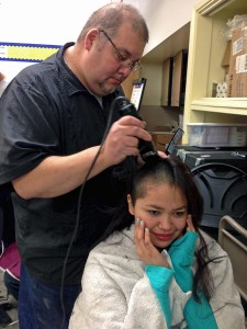 16-year-old Brenda Woods of Bethel buzzes her hair in support of KLA teacher Connie Sankwich who is undergoing chemotherapy. Photo by Angela Denning Barnes, KYUK - Bethel.