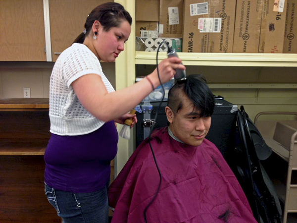 KLA student Theresa Corp buzzes her classmate David Evon's hair in support KLA teacher, Connie Sankwich. Photo by Angela Denning Barnes, KYUK - Bethel.