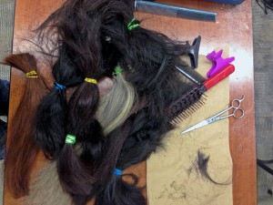 Ponytails pile up as KLA students and teachers donate their hair in support of Connie Sankwich and others with cancer. Photo by Angela Denning Barnes, KYUK - Bethel.