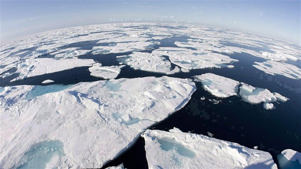 Ice floes float in Baffin Bay between Canada and Greenland above the Arctic circle on July 10, 2008. The seven lowest levels of sea ice cover have all been recorded in the last seven years. Photo by Jonathan Hayward, Canadian Press.