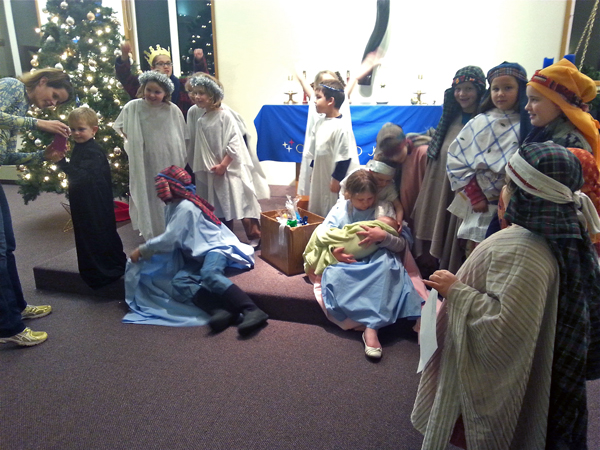 The cast of the living nativity after the show. Photo by Annie Ropeik, KUCB - Unalaska.
