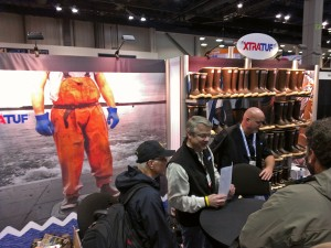 "XtraTuf reps telling fishermen at the Pacific Marine Expo in Seattle that their boots are not just ""sort of tough"" anymore. Photo courtesy KDLG."