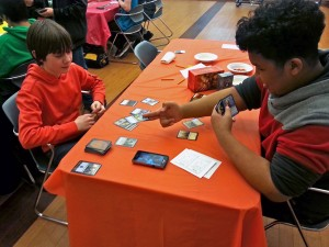 Johnny Khongsuk plays a spell in a Magic game against Kennan Jordan during the tournament. Photo by Annie Ropeik, KUCB - Unalaska.