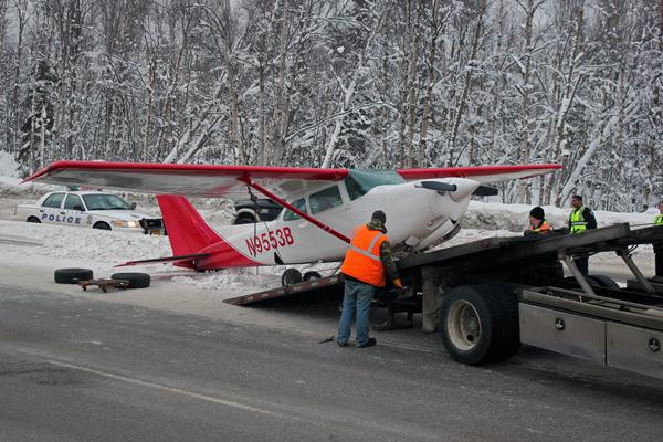 Crews load the Cessna 172 Cutlass onto a tow truck. Photo by Josh Edge, APRN - Anchorage.