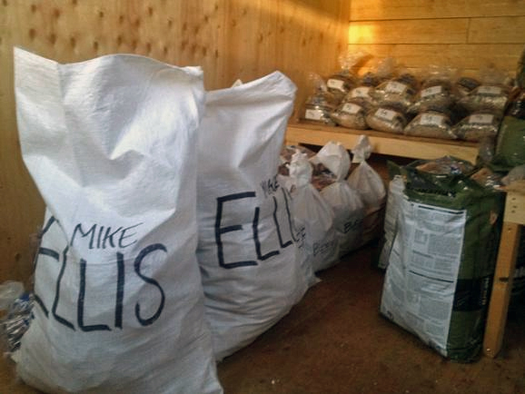 Mike Ellis spent more than a week organize food and gear for his drop bags. Photo by Emily Schwing, KUAC - Fairbanks.