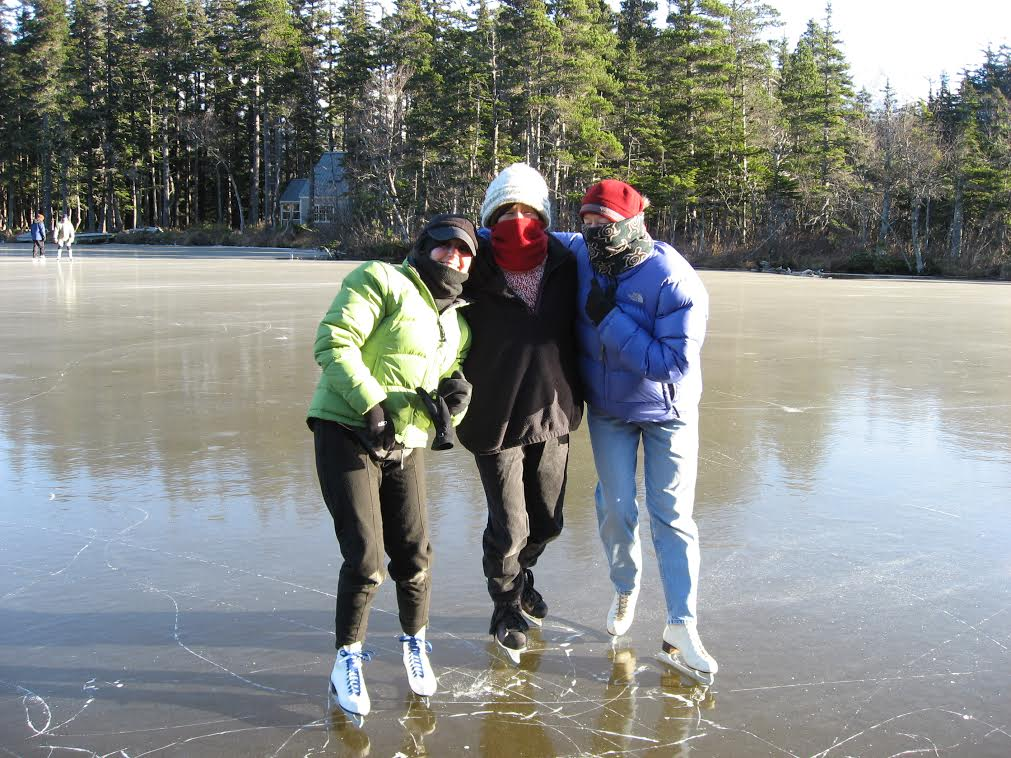 Mira Erickson, Jeanne Kitayama and Sandy Barclay skating on Rutzebeck Lake south of Haines. Photo courtesy Tom Morphet.