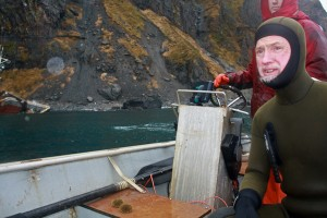 Dan Magone and his sea urchins in the skiff after the survey dive. Photo by Annie Ropeik, KUCB - Unalaska.