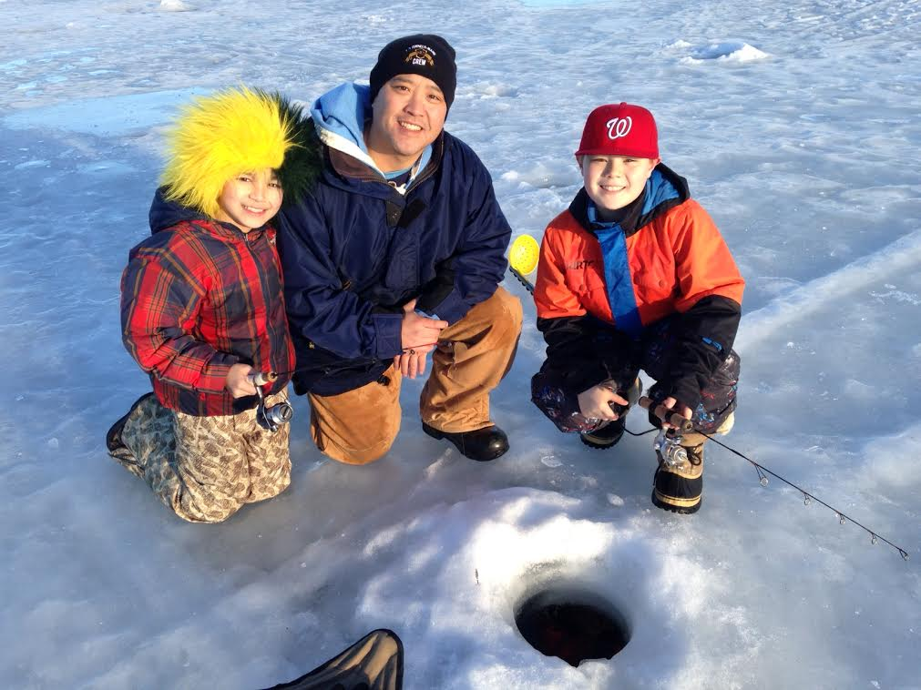 Matt Sugita (center) and his sons Skyler and Teran ice fishing at Jewel Lake in Anchorage. Photo by Charles Wohlforth.