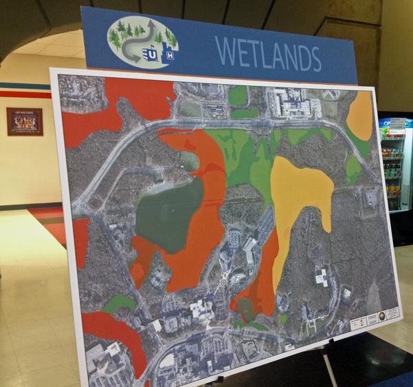 A poster delineates the wetlands throughout the U-Med area. Photo by Josh Edge, APRN - Anchorage.