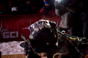 Moments after arriving at the finish line, Dallas Seavey crouches down in his sled, overcome with emotion. KNOM Photo.