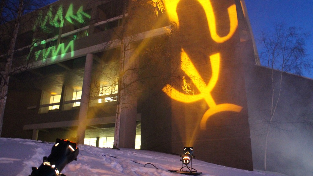 Glyphs projected on to the library facade.