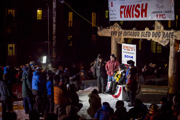 2014 Iditarod champion Dallas Seavey celebrates his victory in Nome. (Photo by David Dodman, KNOM Radio Mission)