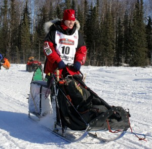 Aliy Zirkle heads out of Willow at the start of the 2014 Iditarod. Photo by Josh Edge, APRN - Anchorage.